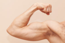 Strong Male Arm With Biceps. Close Up Photo