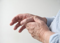 A Man Has Pain In His Thumb